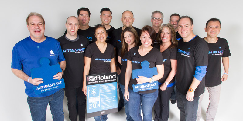 Roland staff members supporting autism awareness