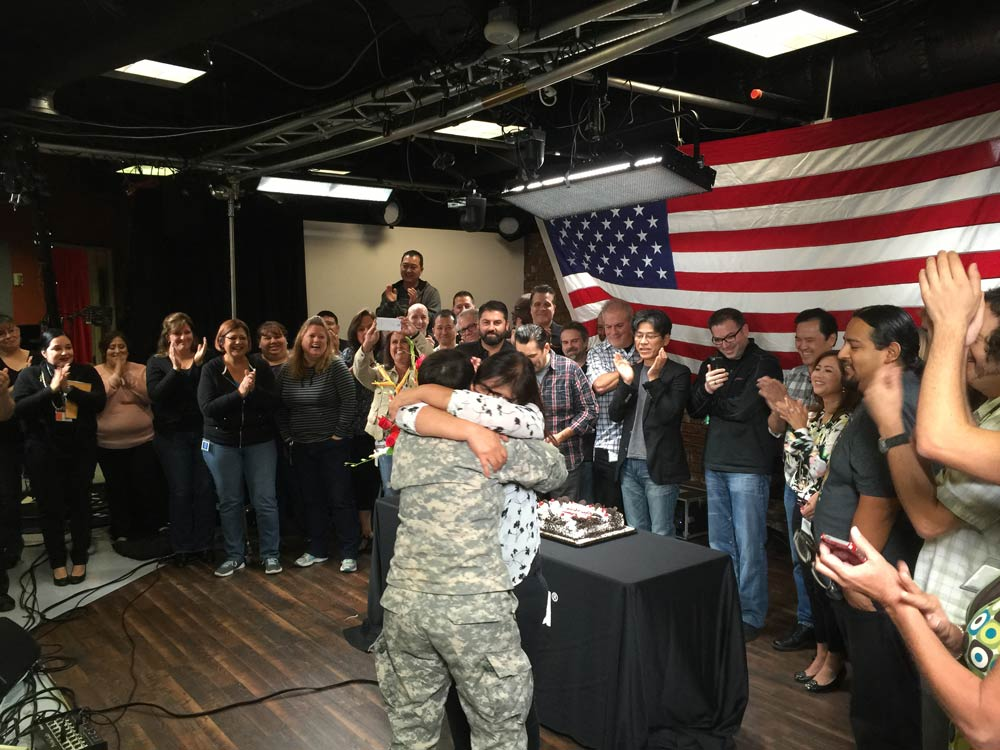 Army Specialist Kim received quite a hug from Mom.
